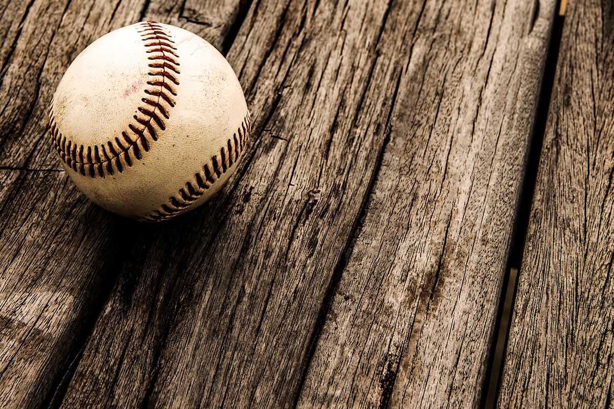 Old Baseball on Wood