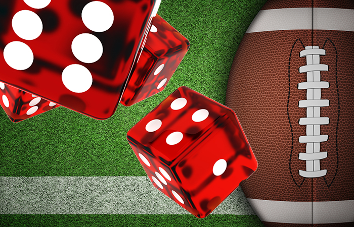 photo of dice superimposed over a football to symbolize gambling