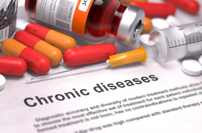 photo showing the words chronic diseases next to bottle of pills and drug needle