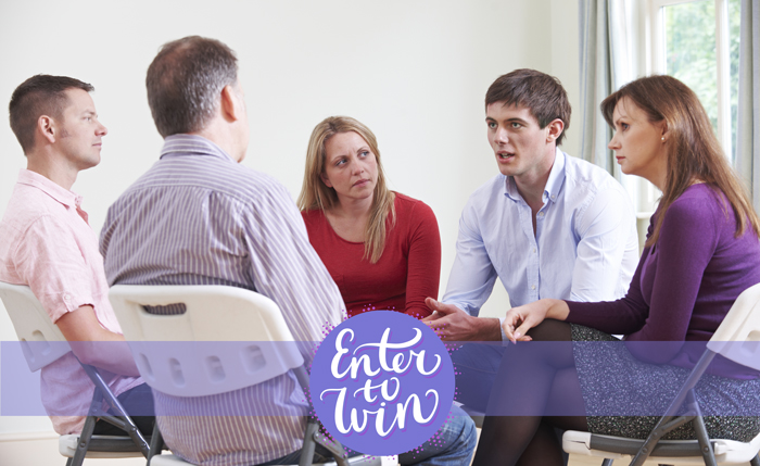 people sitting in a circle during a group therapy session with superimposed text that reads enter to win
