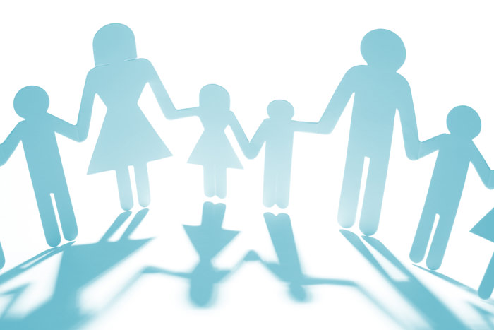 paper cutouts of parents and children holding hands represent our family programs